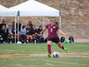 Freshman Samantha Belmonte uses her left foot to send a pass upfield. (Ally Beckwit/Lariat)