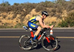 Cyclist accelerates through second leg of the triathlon in San Clemente. (Andrea Clemett/ Lariat)