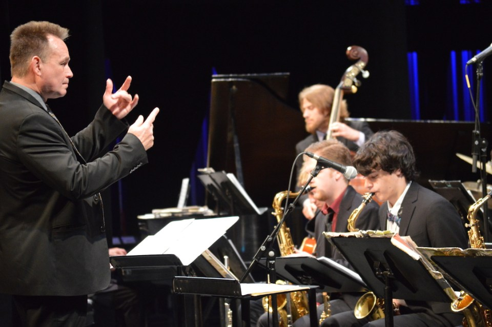 High school student Ben Chasin follows the conducting of jazz instructor Joey Sellers. (Andrea Clemett/ Lariat)