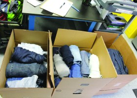Boxes filled with donations of jeans for the event. Photograph taken by Lariat staff