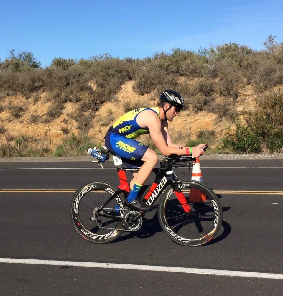 Biker accelerates through second leg of the triathlon. (Andrea Clemett/ Lariat)