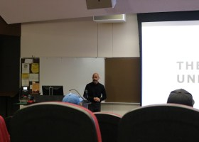 Speaker Derek Sabori presenting a lecture on sustainable fashion for Earth Week at Saddleback College. (Ashley Hern)
