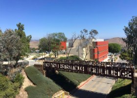 Saddleback College's southern pedestrian bridge, with the Sciences Building in the backgroud. (Staff)