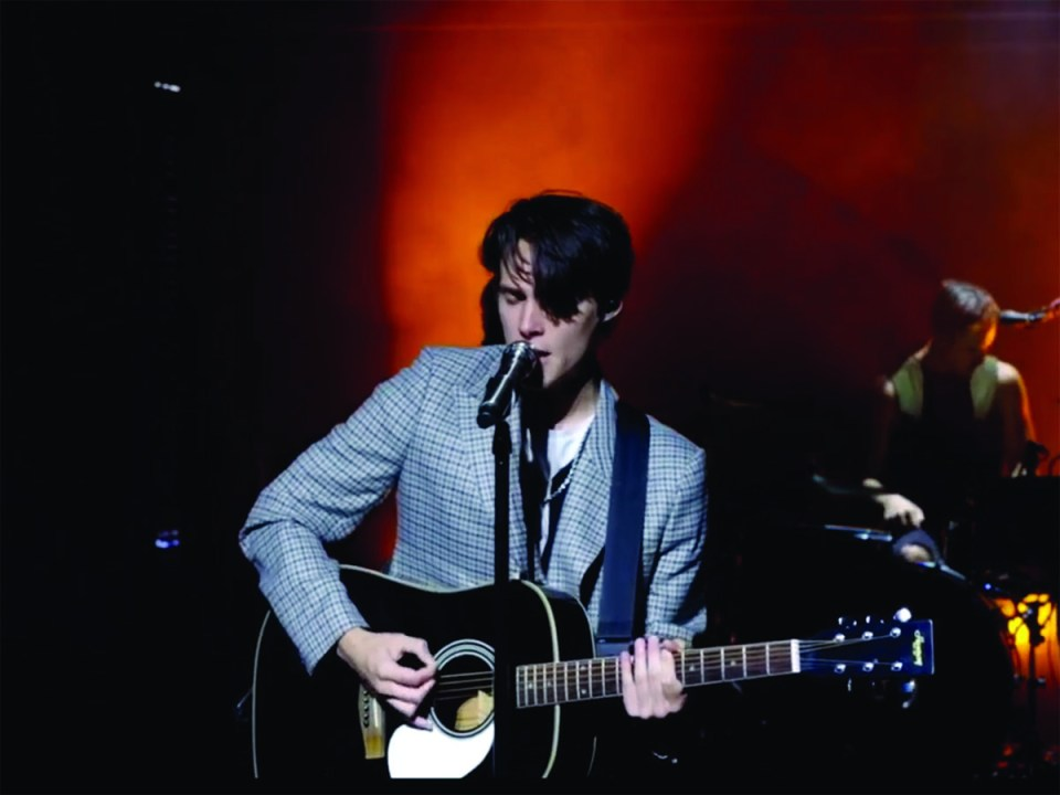 """Using acoustics to balance with their alternative rock set, Boyer plays during """"Poser."""" (Michael L. Costa)"""