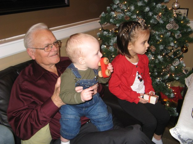 Uncle Abe (or Opa to the little ones) didn't mind lending a hand to hold a great grandchild.