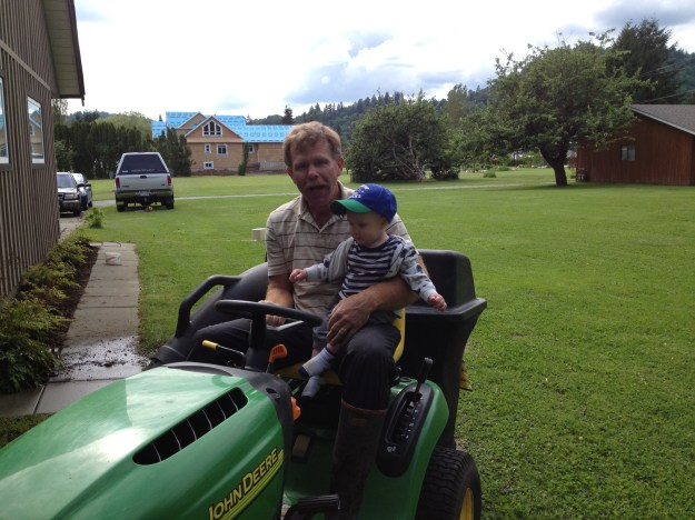 It's a right of passage to ride the mower with Grandpa.