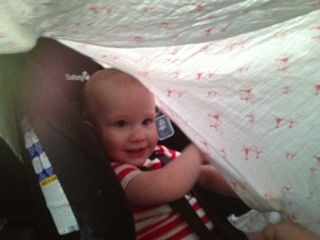 I rigged up a little blanket fort to keep the sun off of him. But he preferred to rip it down and play peekaboo.