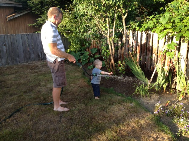 Helping Grandpa water the flowers.