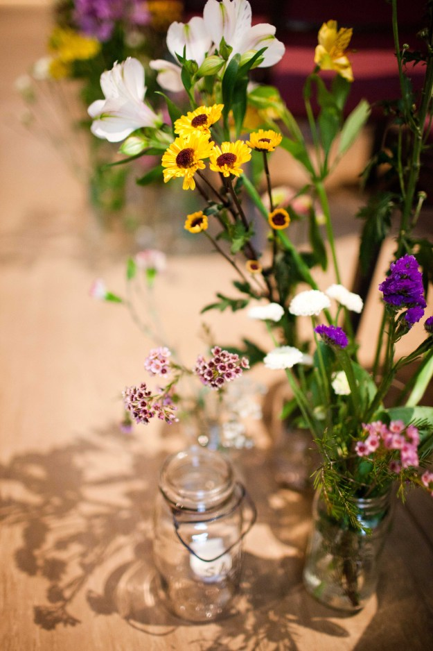 The flowers that lined the aisle later became the flowers for the reception tables.