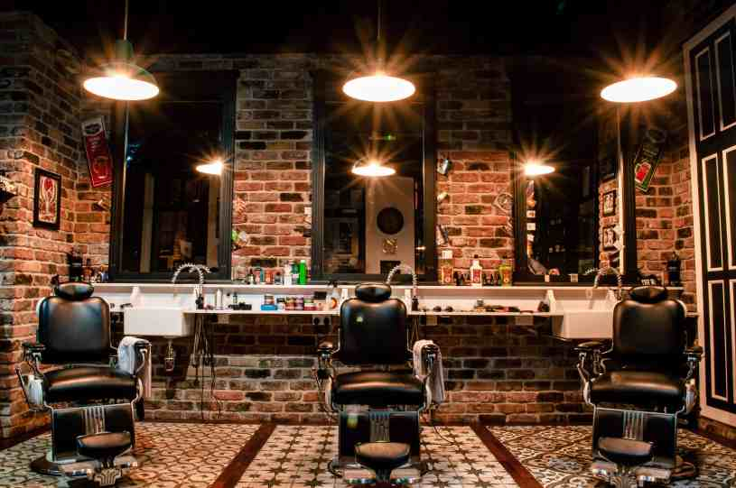 Barber shop with bricked walls and three chairs