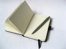black-notebook-with-pencil-1057117-639x474