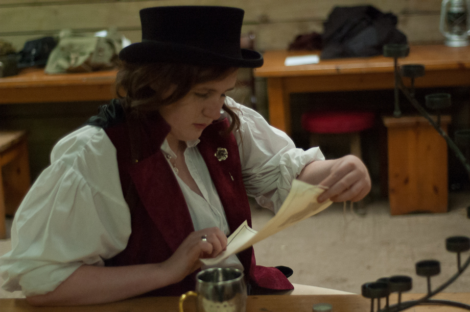 A character examines a scroll at Forest Argent larp