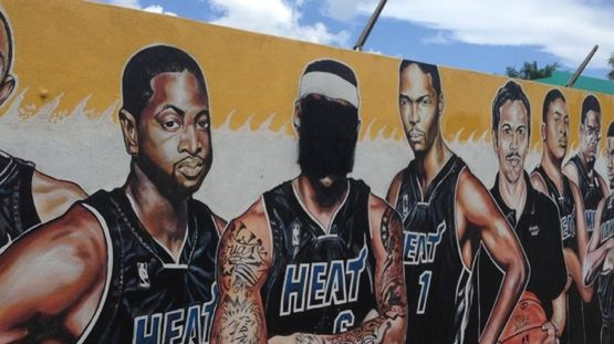reputable site a9be6 ae2f4 Miami Heat Fans Burn LeBron James Jersey, Deface Mural ...