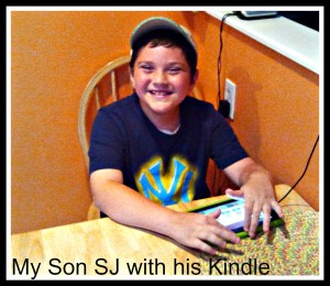 Son playing on his Kindle