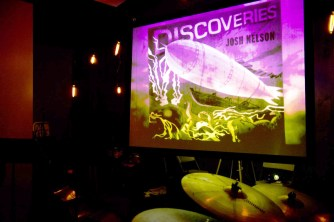 photo of projection of Discoveries art at Josh Nelson Discoveries