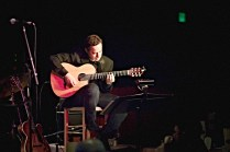 photo of Larry Koonse Solo playing guitar onstage.