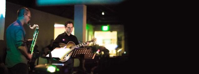 photo of Brian Walsh playing saxophone beside Larry Koonse playing guitar