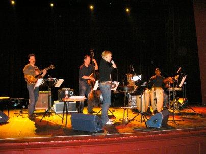 photo of Larry Koonse with Aga Aaryan, Darek Oles, and Munyungo Jackson performing on stage