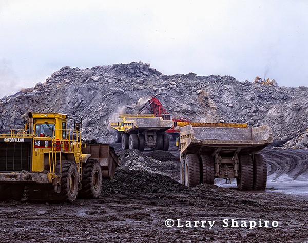 giant earth moving equipment at coal mining operation