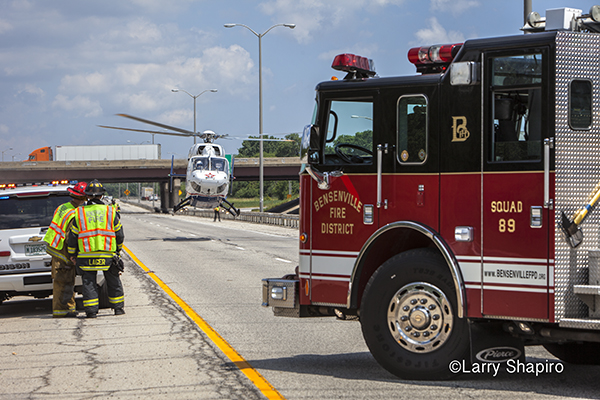 BK117 medical helicopter lifts off from a highway