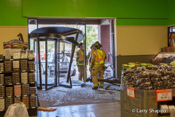 storefront demolished by car