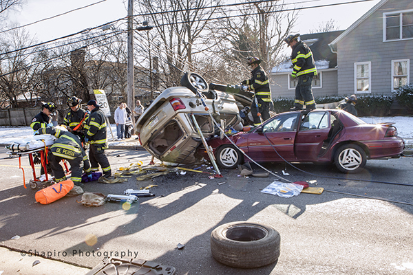 firemen rescue multiple victims from a car crash
