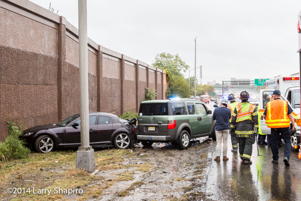 highway crash scene in the rain