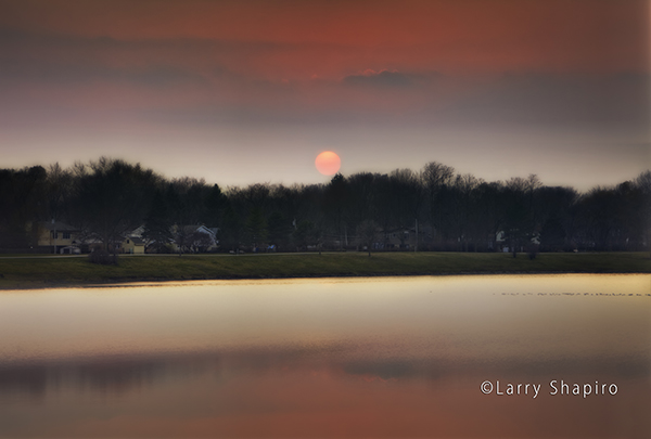 Winter sunset across a small lake