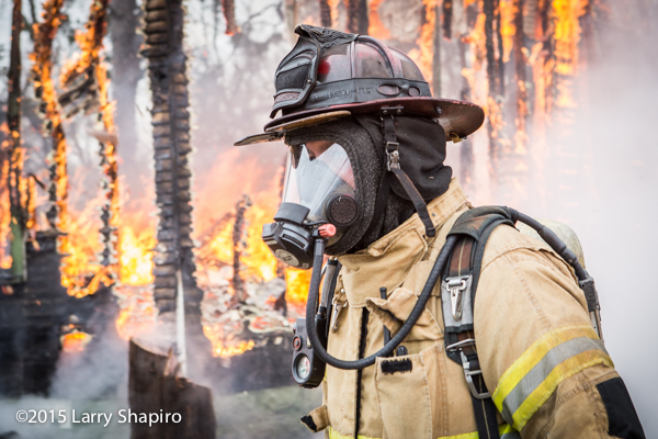 fireman with mask hood and helmet full PPE