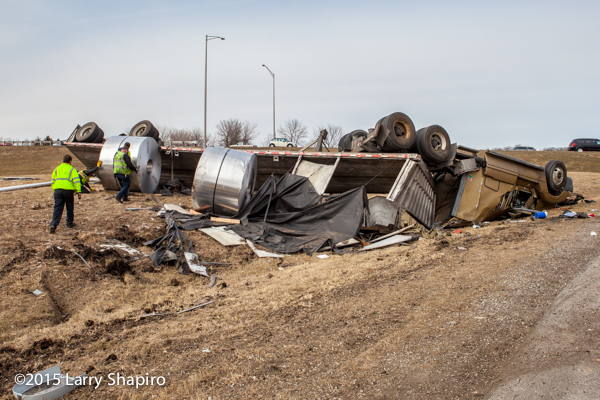 tractor trailer flipped over with steel coils