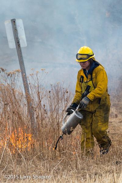 firefighter using a drip torch
