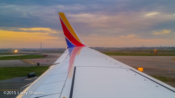 Southwest Airlines plane with the Washington Monument and US Capitol
