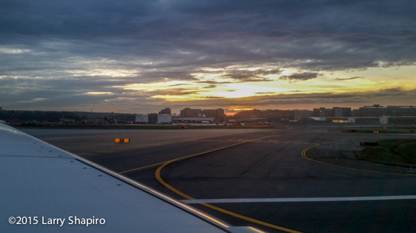 taking off from Reagan National Airport at sunset