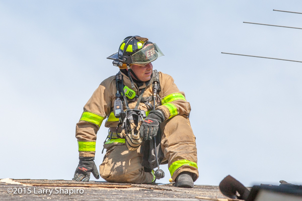 fireman on the roof of a building