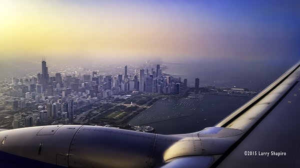 Sunset over the Chicago skyline and lakefront from an airplane