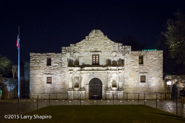 a photo of The Alamo at night