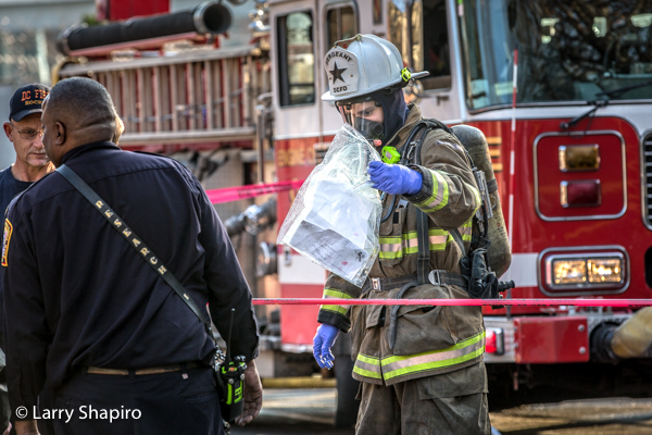 firefighter holds suspicious package after ham at scare