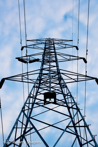 silhouette of high voltage power line support