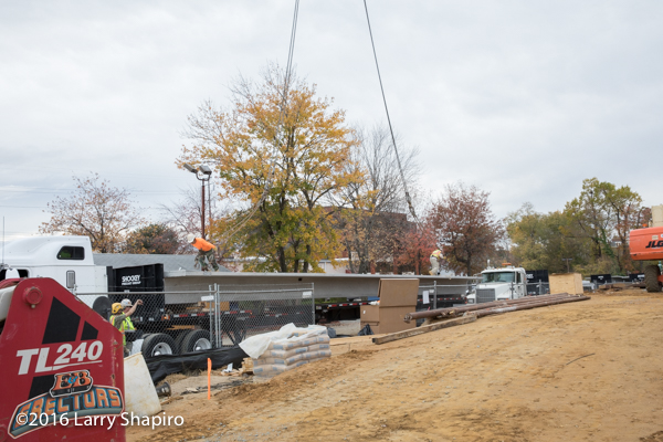 crane lifting precast concrete