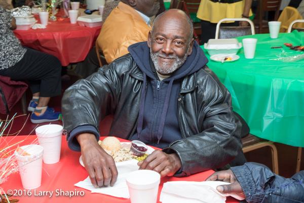 African American man enjoying free Thanksgiving meal