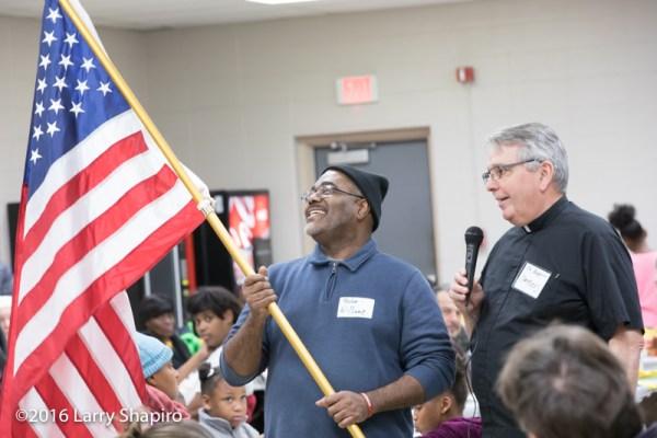 veteran hold flag at Thanksgiving dinner