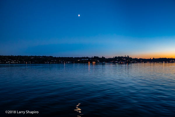 the moon at dusk over the Puget Sound
