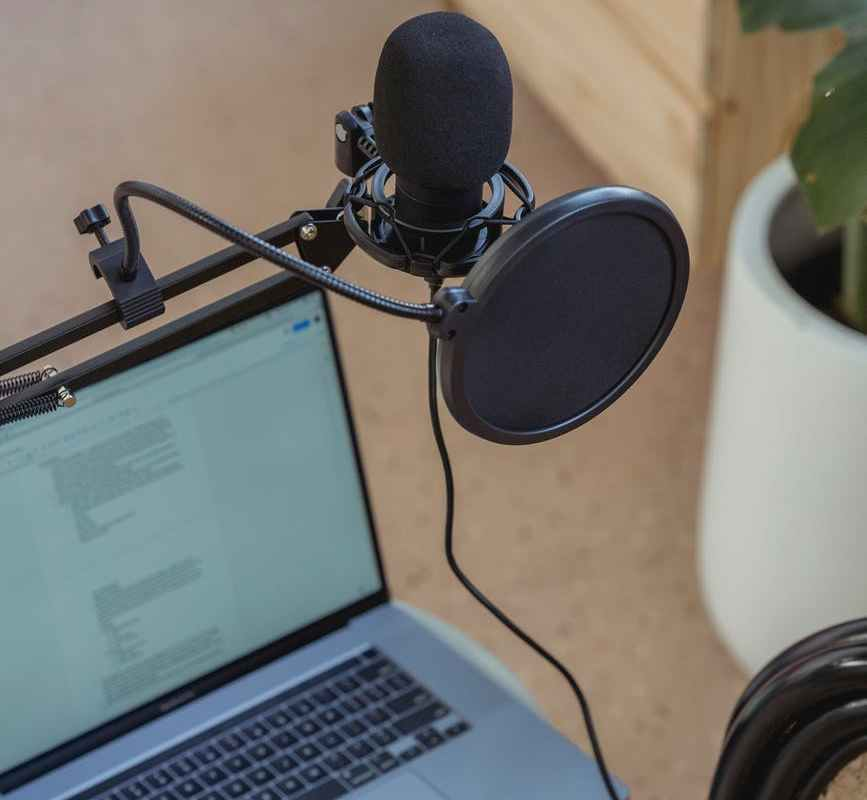 microphone on tripod attached to laptop in studio