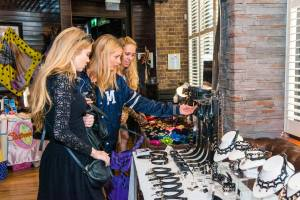 shoppers browsing at erotic alternative fashion popup Le Boutique Bazaar. Co-Founder Alexandra Houston interview with erotic marketing agency, Lascivious Marketing. [credit: Hyder Images]