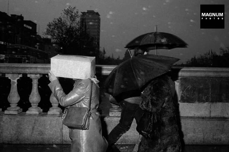 """Martin Parr. IRELAND. Dublin. O'Connell Bridge. From 'Bad Weather"""". October. 1981."""
