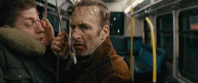 Bob Odenkirk in scene of Bus. Nobody (2021)