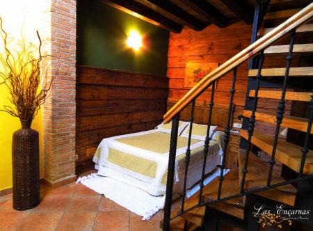 Dormitorio en casa rural abuhardillado