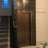 Bronze fretwork interior wall panelling
