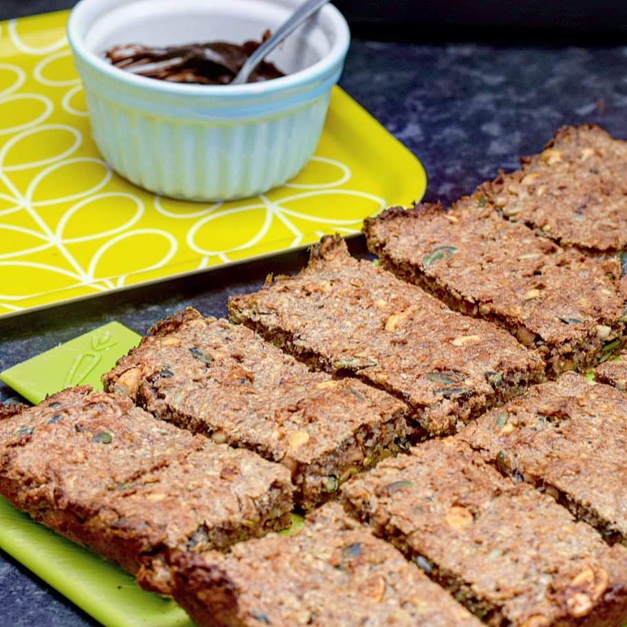 Banana oat bars recipe with peanut butter, nuts and seeds