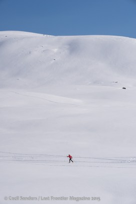 Cross country skiing in Hatcher Pass. More skiers snowshoeing to steeper terrain above. www.cecilsandersphotography.com